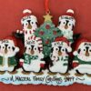 6 penguins together on the decoration. A Christmas tree is positioned in the middle. There is 2 penguins on top of the row of 4. They are all wearing hats and these can be personalised with the names on them. They are standing on snow and this area can be used for a large message.